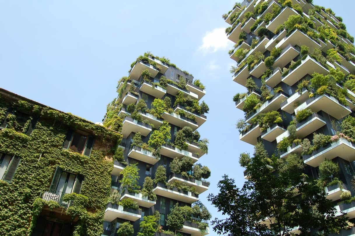 Two tower blocks covered in lush greenery towering into the sky